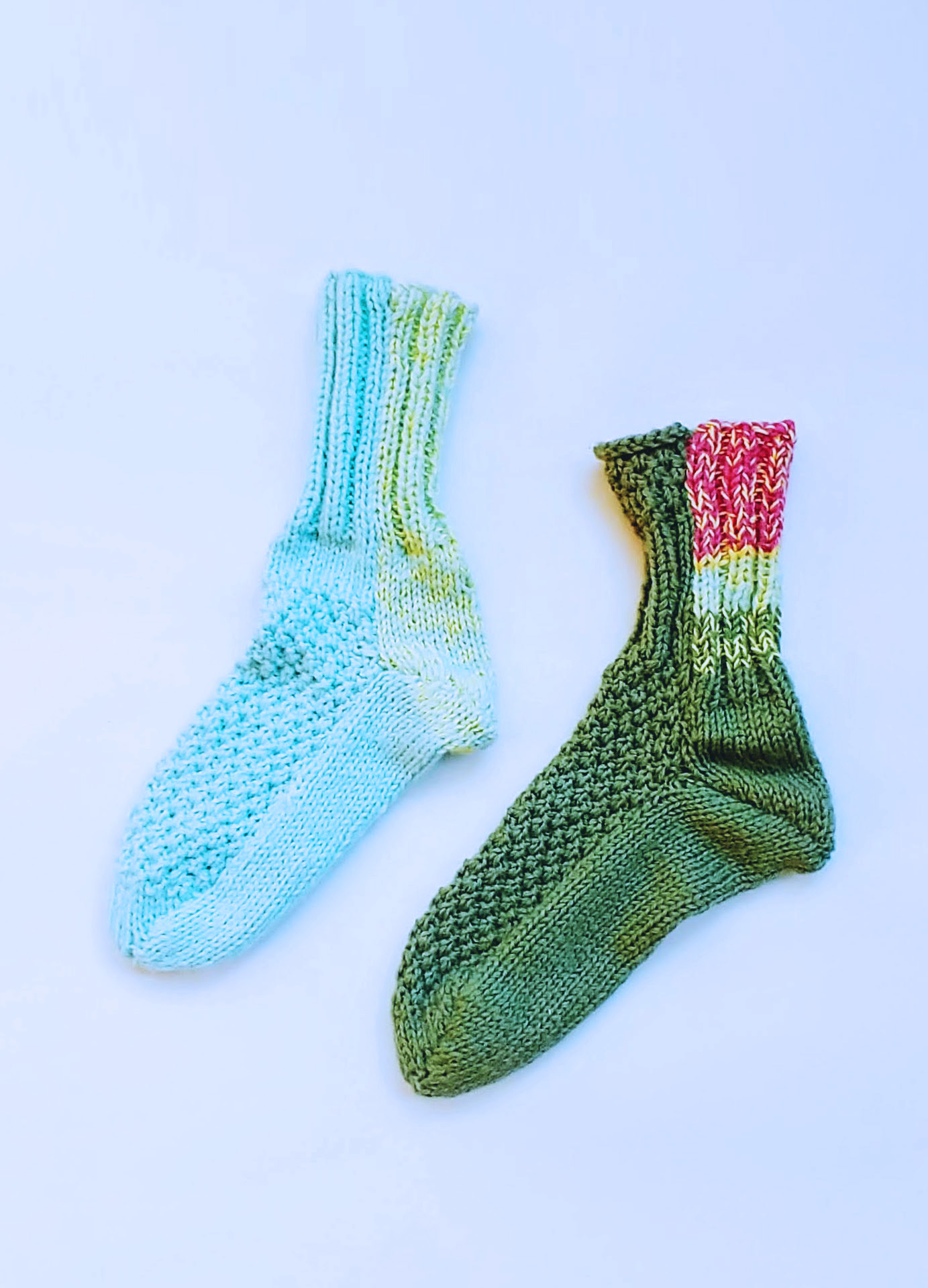Two Knitted Socks - Blue and Green